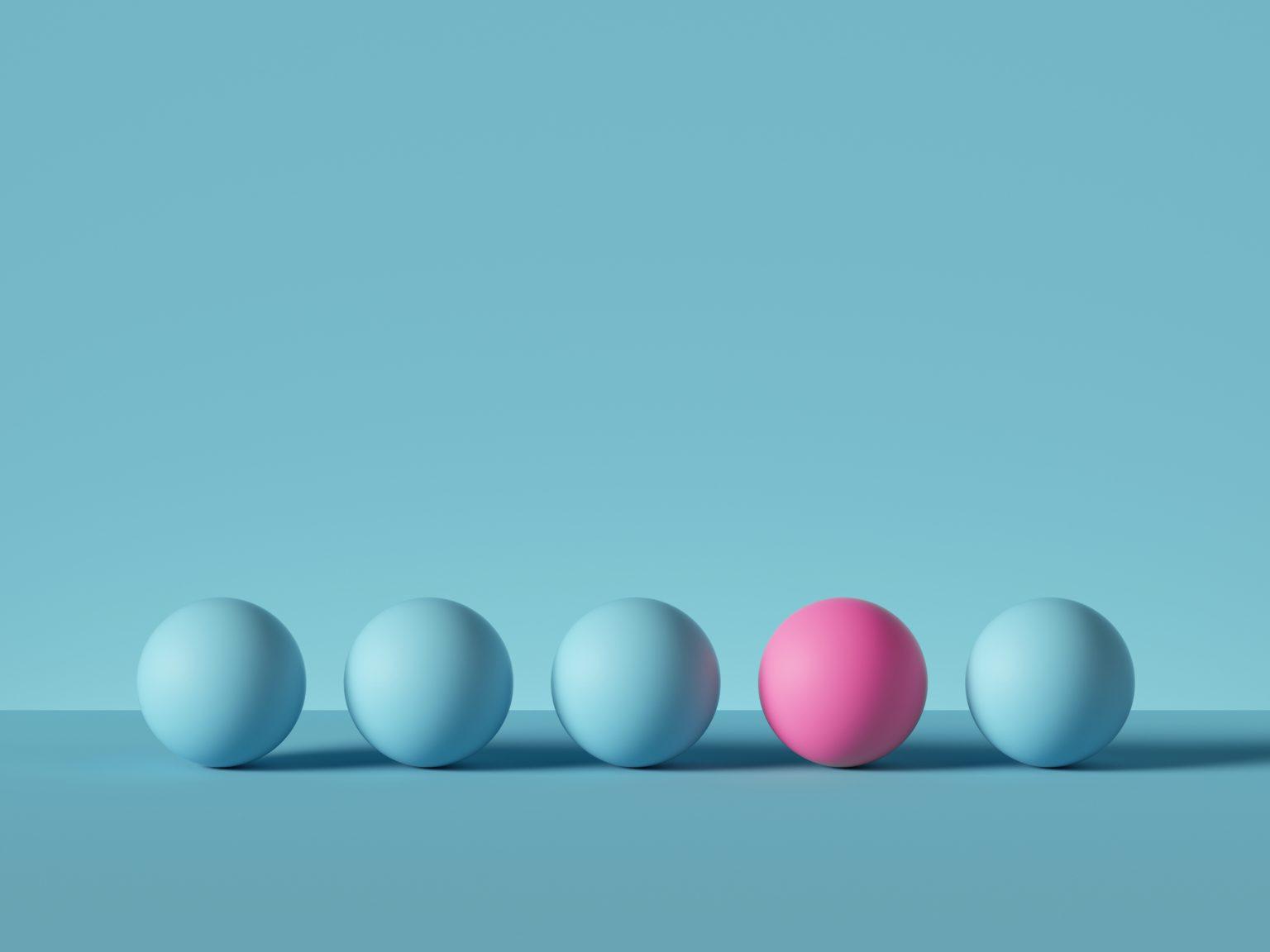 Image de cinq sphères 3D consécutives, la quatrième étant d'une couleur différente du reste.