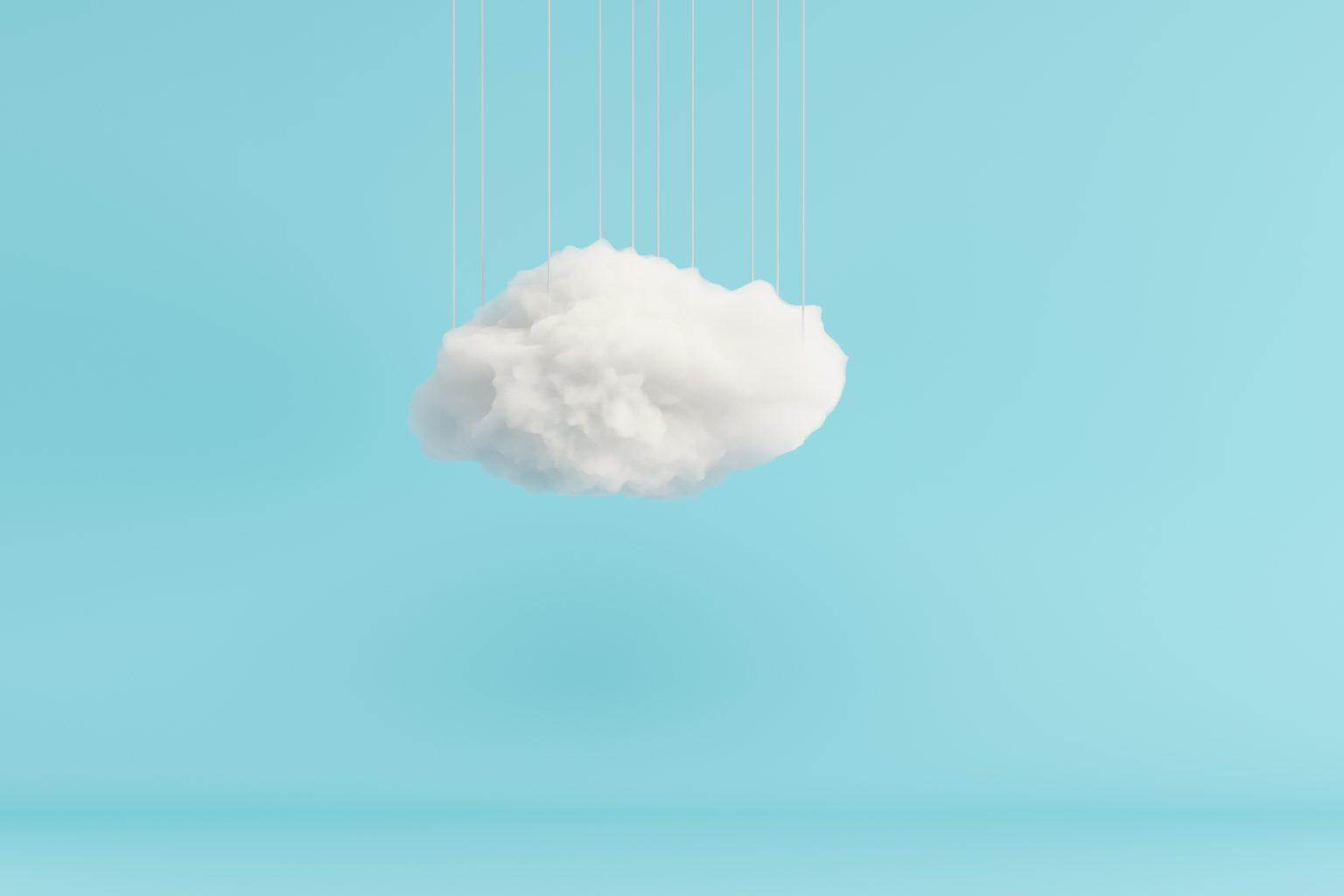 Image d'un nuage blanc en 3D devant un fond bleu uni